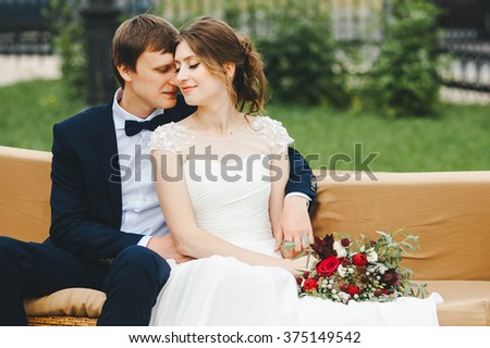 Beautiful bride and groom in park. wedding day - stock photo