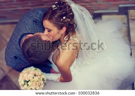 beautiful  bride and groom kissing. top view - stock photo