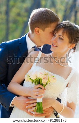Beautiful Bride and groom together in park - stock photo