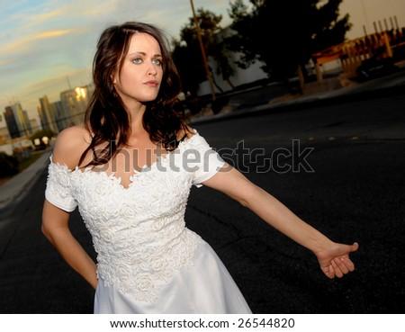 Beautiful Bride hitch hiking in las Vegas - stock photo