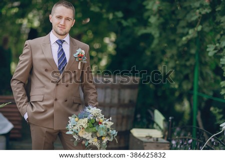beautiful bride in a brown suit and tie