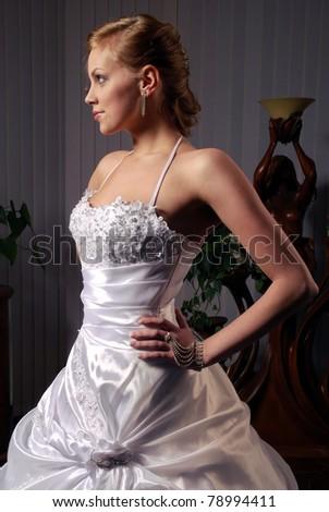 beautiful bride in a luxury wedding dress - stock photo