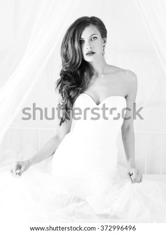 beautiful bride in a wedding dress with bare shoulders and veil. Black and white. - stock photo