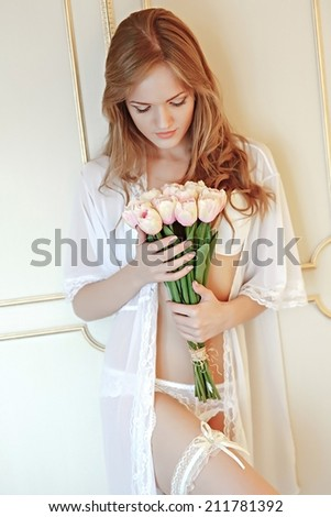Beautiful bride in her bedroom. Soft light. morning bride