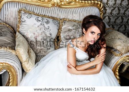 Beautiful bride in luxury hotel room - stock photo