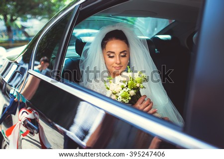 beautiful bride in the car - stock photo