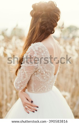beautiful bride in the field with cotton - stock photo