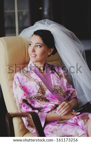 Beautiful bride in the morning at home.  Adorable fiancee. - stock photo