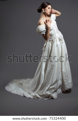 beautiful bride in the wedding gown - stock photo