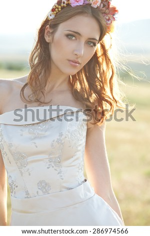 Beautiful Bride in wedding day on sunset. - stock photo