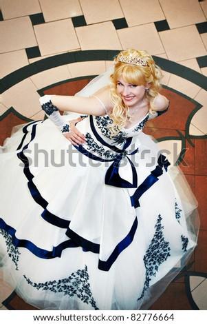 Beautiful bride in wedding dress indoor - stock photo