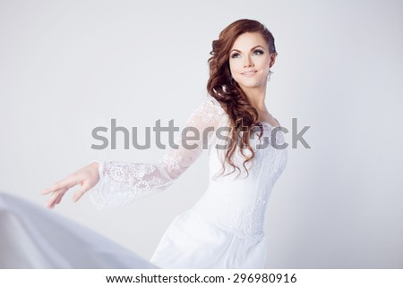 Beautiful bride in wedding dress, white background, close up - stock photo