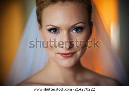 Beautiful bride indoors portrait, young happy woman in wedding dress lifestyle. soft focus. - stock photo
