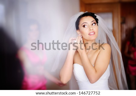 beautiful bride is getting ready - stock photo