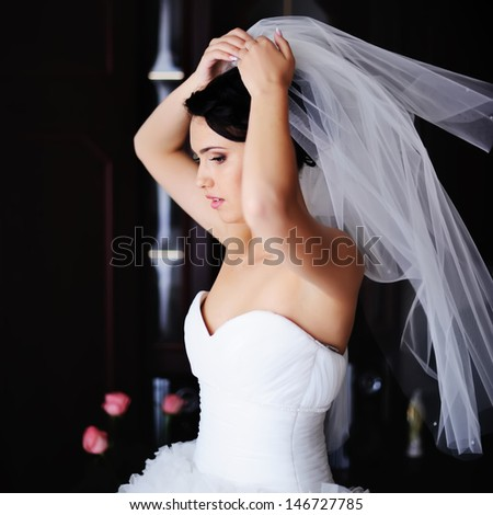 beautiful bride is getting ready in the morning