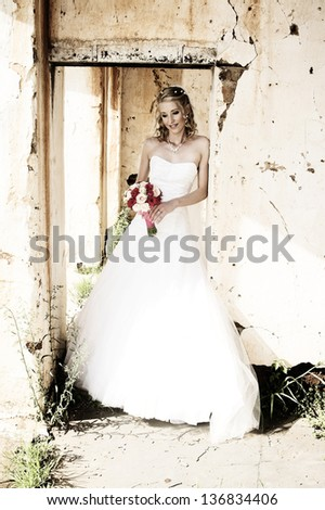 Beautiful bride on her wedding day in white - stock photo