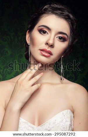 Beautiful bride on vintage green interior background. Studio shooting. Beauty and fashion. Bride in her wedding day. Portrait of a happy bride - stock photo