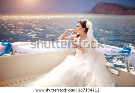 Beautiful Bride on yacht at wedding day. Luxury wedding. Newlywed woman outdoors. - stock photo