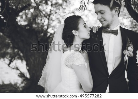 Beautiful bride outdoors in park