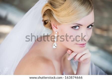 Beautiful bride outdoors - soft focus - stock photo