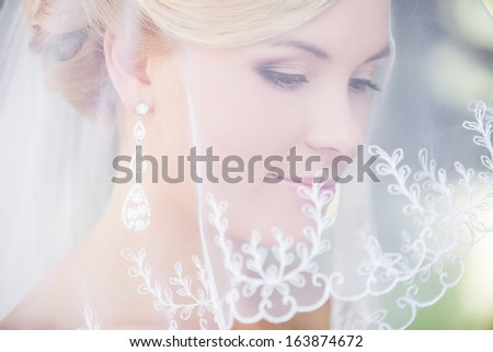 Beautiful bride outdoors - soft focus - stock photo