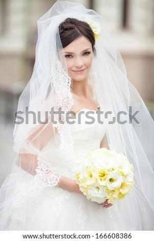 Beautiful bride outdoors, soft focus. - stock photo