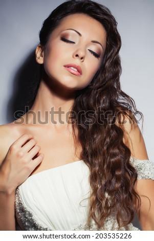 Beautiful bride portrait in studio - stock photo