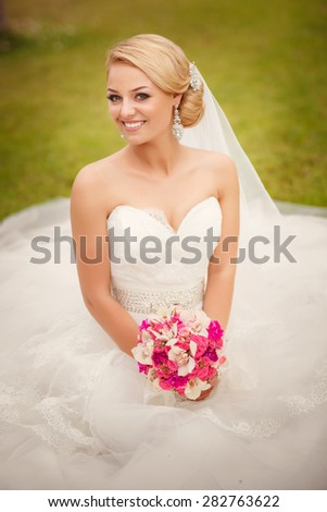Beautiful bride Portrait Outdoors woman in wedding dress marriage day girl in white dress, happy newlywed woman smiling in bridal dress, soft focus, series - stock photo