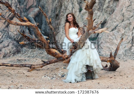 Beautiful bride standing on branches