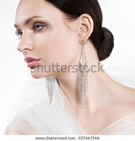 beautiful bride wearing a dainty jewellery - stock photo