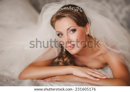 Beautiful Bride wedding day outdoors, happy bride woman with wedding flowers bouquet. Gorgeous bride vogue style model. Newlywed girl in green park. series, sunset and soft focus - stock photo