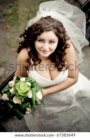 beautiful bride with a neckline looks up - stock photo