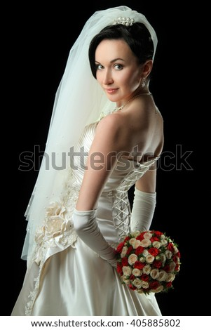 beautiful bride with a wedding bouquet of flowers. portrait with bouquet. happy smile.