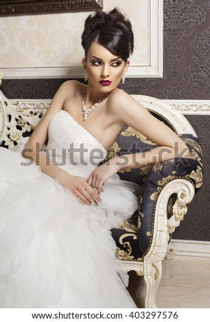 beautiful bride with fashion hairstyle and make-up  in luxury interior