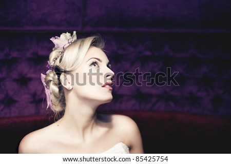 Beautiful bride with fashion wedding hairstyle - stock photo