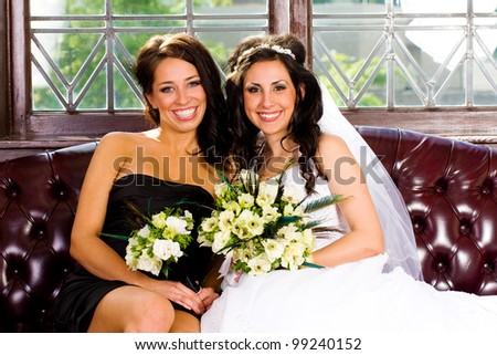 Beautiful Bride with her pretty Bridesmaid