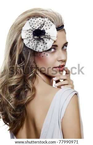 beautiful bride with long blond hair looking over her shoulder with a fresh smile and wearing vintage flower hair accessories - stock photo