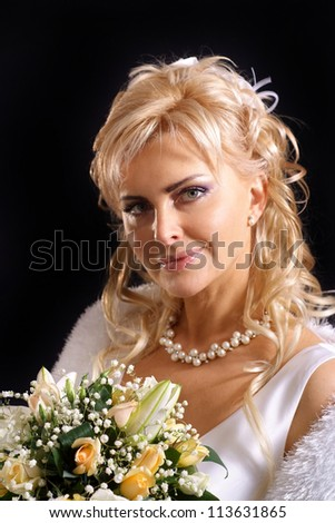 Beautiful bride with perfect hair in a white dress with her groom and witness