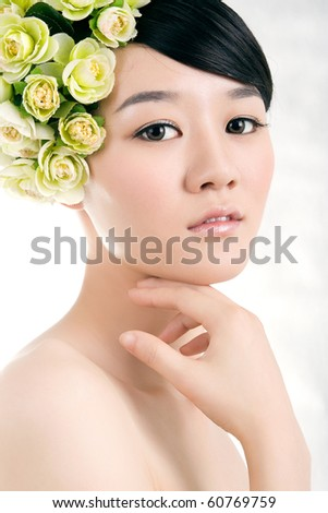 Beautiful bride with perfect natural makeup,flowers on head - stock photo
