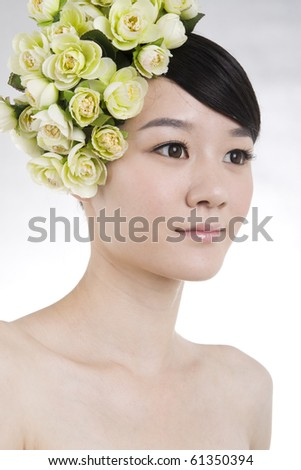 Beautiful bride with perfect natural makeup,flowers on head,smiling - stock photo