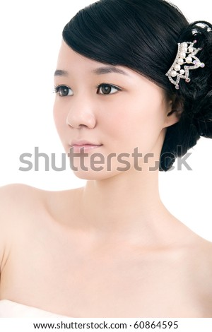 Beautiful bride with perfect natural makeup,head-wear on head - stock photo