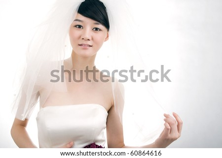 Beautiful bride with perfect natural makeup,smiling,wearing mantilla - stock photo