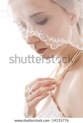 beautiful bride with veil covering her face - stock photo