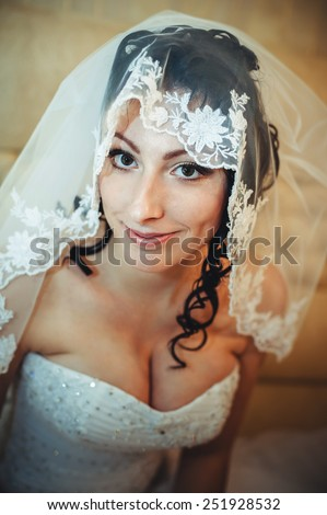 Beautiful bride with wedding flowers bouquet, attractive woman in wedding dress. Happy newlywed woman. Bride with wedding makeup and hairstyle. Smiling bride. Wedding day. Gorgeous bride. Marriage. - stock photo