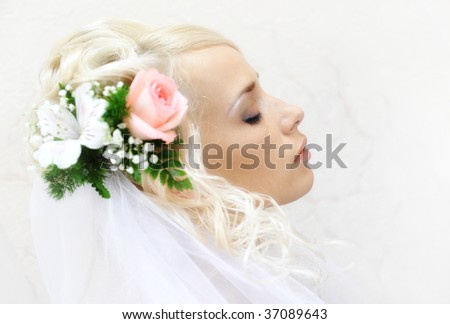 Beautiful bride with wedding hairstyle side view