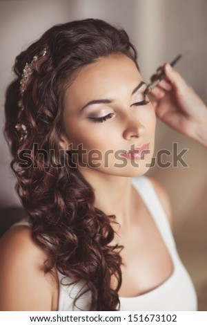 Beautiful bride with wedding makeup and hairstyle, attractive newlywed woman have final preparation for wedding. Bride waiting groom. Happy newlywed. Marriage. Wedding day moments. Bride makeup. - stock photo