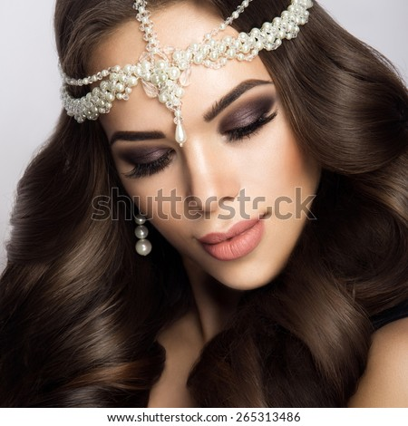 Beautiful bride with wedding makeup and hairstyle, attractive newlywed woman have final preparation for wedding. - stock photo