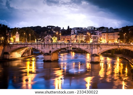 beautiful bridge in the center of Rome in the night - stock photo