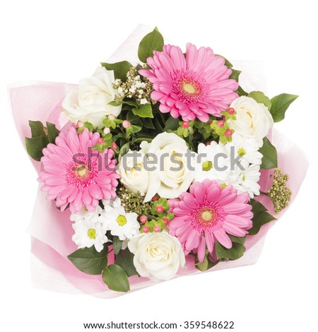 beautiful bright bouquet of flowers of pink roses, white roses and lilies with green leaves in a thin decorative pink paper isolated on a white background - stock photo