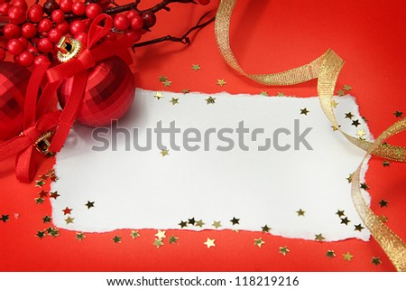 beautiful bright Christmas balls and empty postcard on red background - stock photo